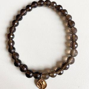 Satya bracelet, like new. Smoky quartz, lotus